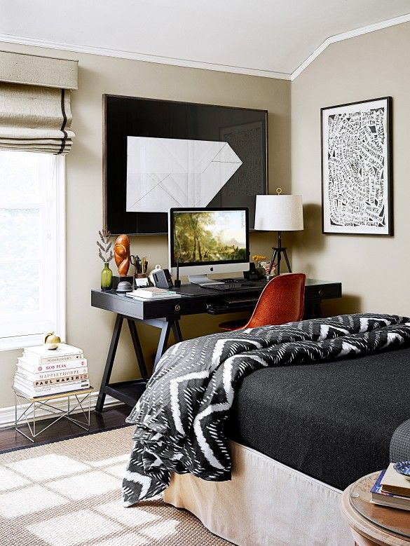 This small-space Los Feliz bedroom designed by Christos Prevezanos features large frame prints, a workstation and a genius layout