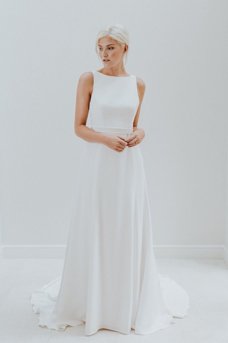 Boat neck wedding dress with open back by Charlotte Simpson