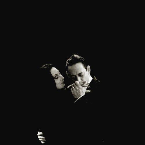 """You frightened me, do it again."" Gomez  (Raul Julia) and Morticia (Angelica Huston)"