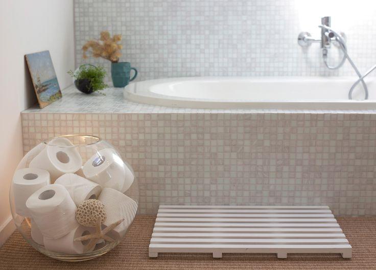 #bathroom ideas #terrarium #glass bowl #toiletpaper #shells #tiles. Staging by Places and Graces.