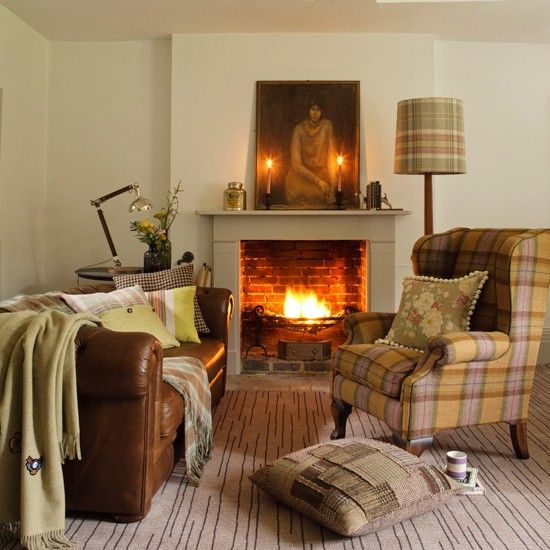 Nothing better than a warm fire with comfy furnishings - love how this look is usable in winter and summer (particularly like the use of plaid)