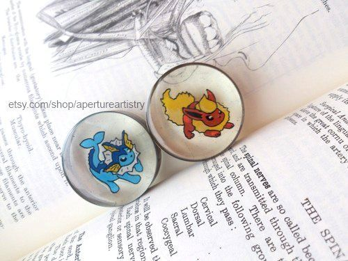 You pick the Pokemon, I draw them into plugs! Pokemon sprite plugs In sizes 10mm and above by ApertureArtistry on Etsy https://www.etsy.com/listing/163526277/you-pick-the-pokemon-i-draw-them-into