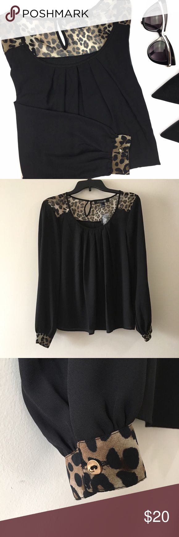 NWT Forever 21 Black Leopard Print Long Sleeve Top NWT. Super elegant blouse with scoop neck and pleated details on front, animal print panels around neck and cuffs. Buttoned cuffs and keyhole closure on the back. 100% polyester. Forever 21 Tops Blouses
