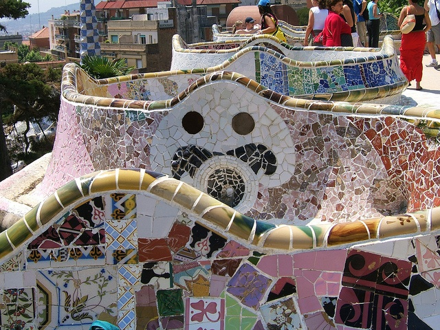 "Parc Güell: the famous undulating bench covered in broken ceramics (""trencadís""), is work of Josep Maria Jujol i Gibert, Catalán Architect:  He worked with Antoni Gaudí on many of his most famous works."