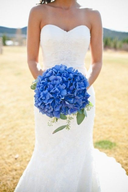 blue hydrangea and peacock feather wedding bouquets - Laci!