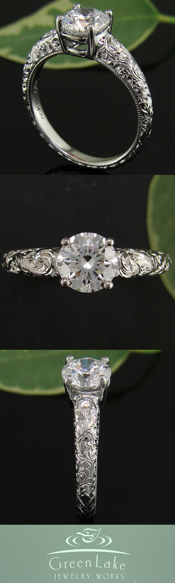 Hand engraved platinum ring with brilliant-cut center diamond.