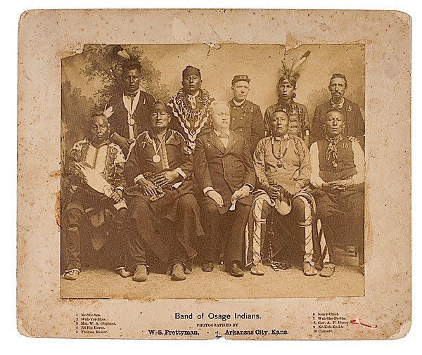 Standing L-R: Me-She-Sea (Osage), Wah-Tsa-Moie (Osage), Maj. W.A. Oliphant (U.S. Army Officer), Ed Big Horse (Osage), Thomas Mosier Sitting L-R: Saucy Chief (Osage), Wah-She-Pe-She (Osage), Alvin Peterson Hovey (Indiana Governor), Ne-Kah-Ko-La (Osage), Claremore (Osage) – 1888