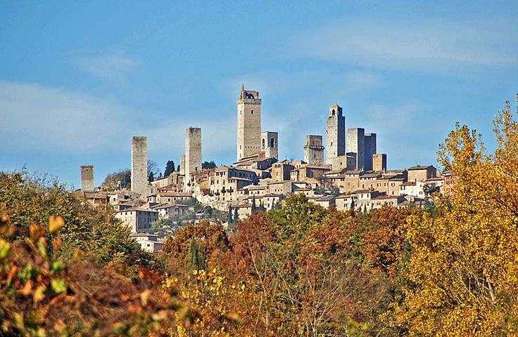 San Gimignano. I have seen this beautiful medieval town and tasted its world famous gelati. i would give anything to go back there in the summer and laze around on the grass surrounded by history and sunflower fields..