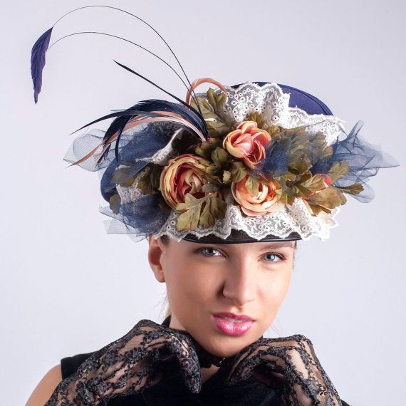 A statement Flower power beret cap hat, suitable for burlesque shows, carnivals and celebrations, being inspired from a military/police cap but made in a blue with a waterfall of flowers, lace and feathers.  The base of the hat is military hat blue, decorated with feathers and flowers. This hat can be worn 2 ways - with visor in front or with the visor in the right side and it looks like a beret this way.  This hat is available in size 22 3/8 (57 cm) For other colors and sizes pleas...