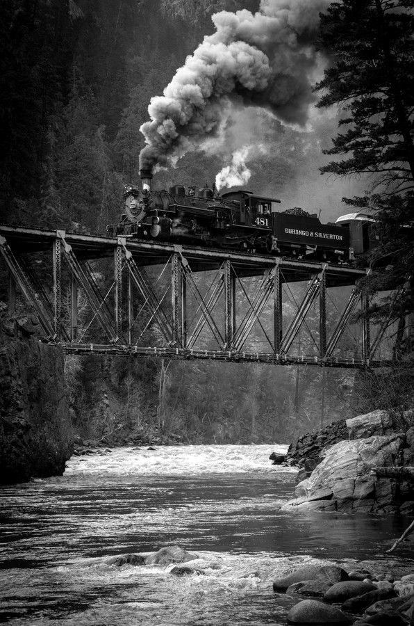 """Above the Animas River in southwestern Colorado, the Durango and Silverton's #481, a 1925 built Baldwin product heads for home in Durango."""