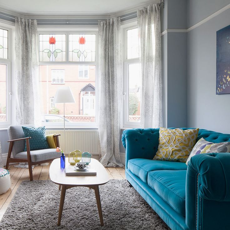 Give a period living room a boost with bold furniture, such as an electric-blue sofa - as seen in this stylish home