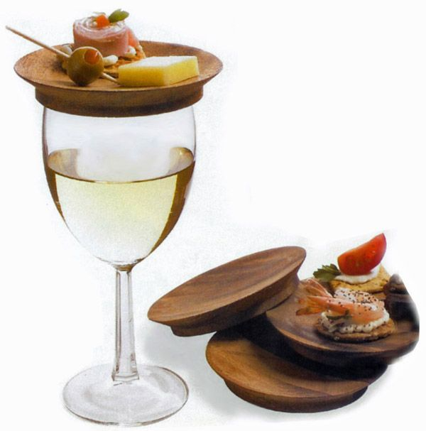 Wine glass top appetizer plates from Catching Fireflies are ultimate appetizer plates that can be easily carried around while sitting on top of your wine glass. Made of Acacia wood the plates come in a set of four at $24.95.
