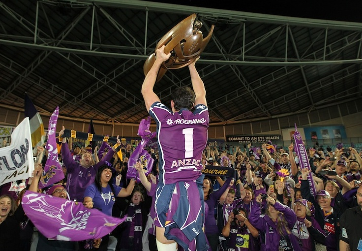 Billy Slater showing the crowd the Premiership trophy!