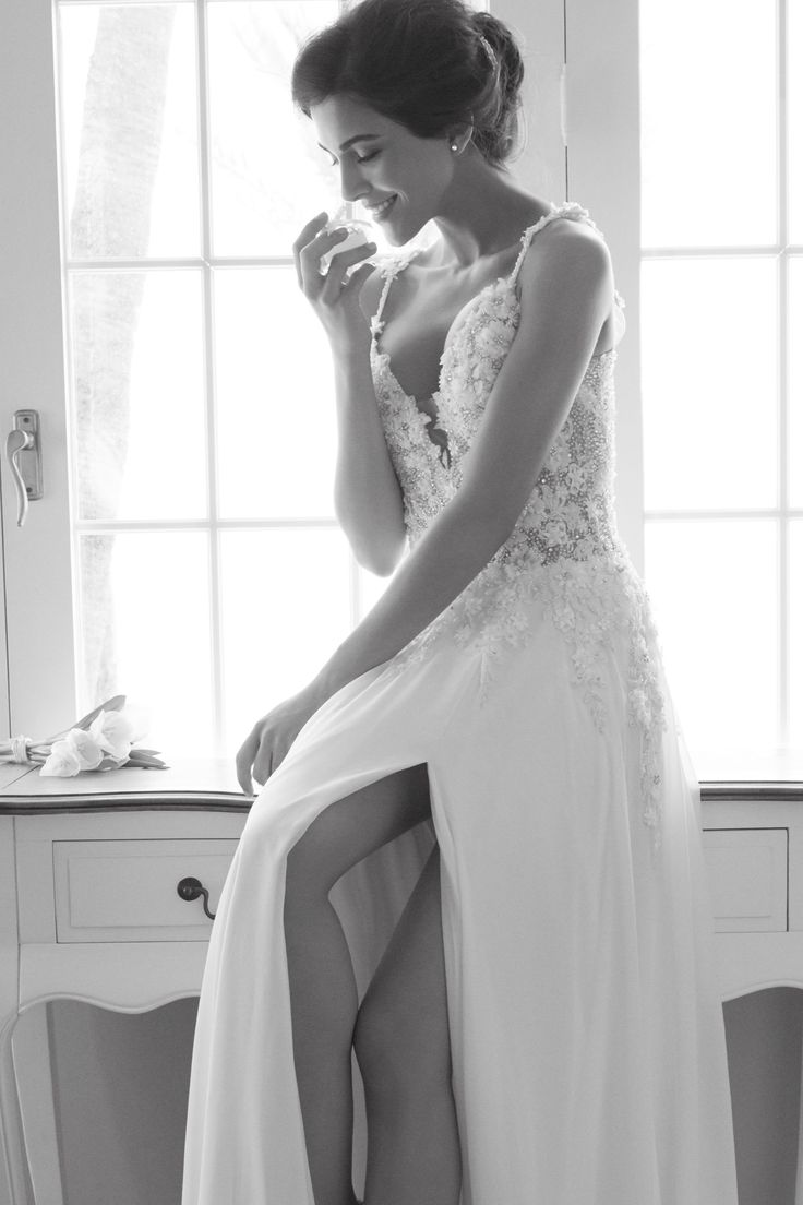 "LIZZY - This lace slim ""A"" line gown has timeless elegance with its classic V neckline made up of floral lace."