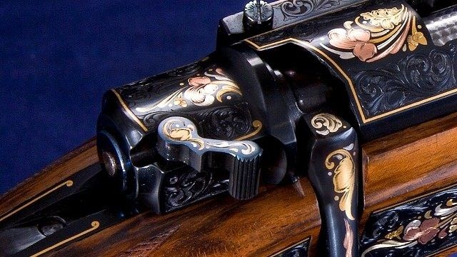 Beautiful engraving on a Mauser 98 by the American Gunsmithing Guild.