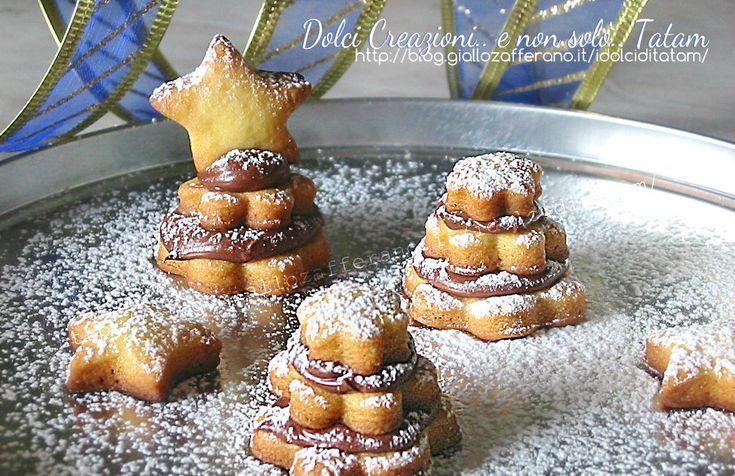Biscotti Alberelli di frolla e Nutella, facili, golosi e graziosi, questi biscotti a forma di albero di Natale renderanno la tavola delle feste ancora più..