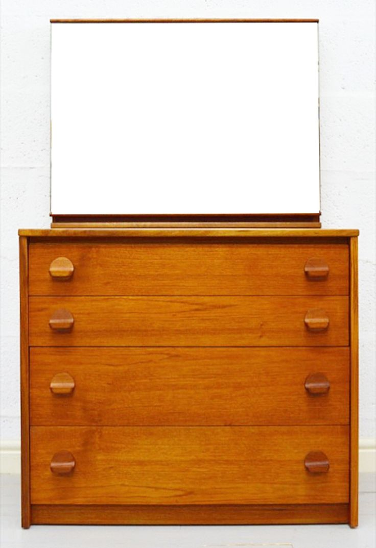 A compact four drawer dressing table/chest of drawers by Stag in a rich amber teak accentuated with circular pull-handles that finish of the piece perfectly, the mirror is removable. We also have a matching chest of drawers. In immaculate condition now fully restored and finished with Danish oil.