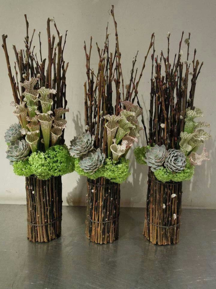Pitcher, hydrangea and dried stick arrangement