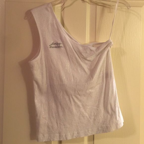 Harley Davidson White shimmer top Houston H-D Harley Davidson White shimmer top Houston H-D. One shoulder, bought on posh. Good condition, no holes of stains. Mancuso H-D Houston, TX Harley Davidson Tops Tank Tops