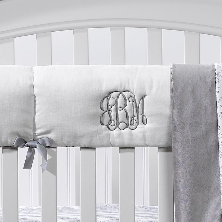 Personalize your nursery with our monogrammed crib rail covers.  Our white rail guard with gray trim offers a classic nursery look.
