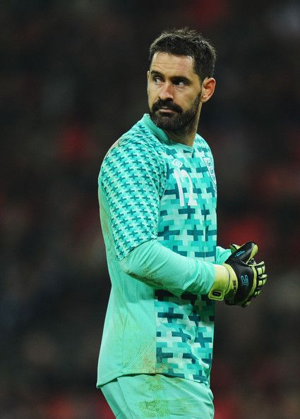 Scott Carson Photos Photos - Scott Carson of England looks on during the international friendly match between England and Sweden at Wembley Stadium on November 15, 2011 in London, England. - England v Sweden - International Friendly