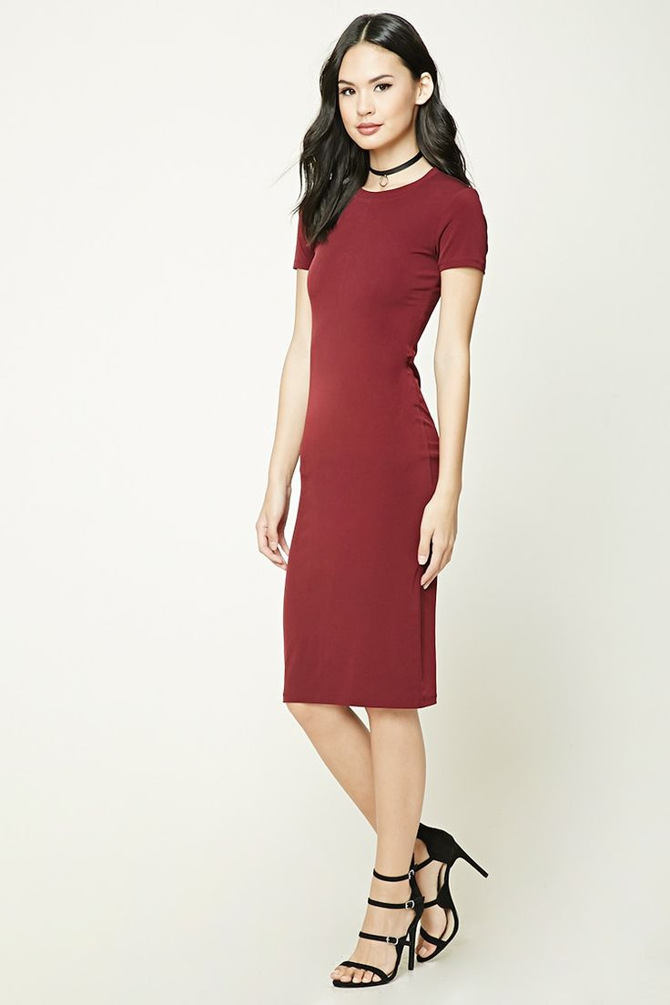 Style Deals - A stretch-knit midi dress featuring a round neckline, short sleeves, and a back slit.