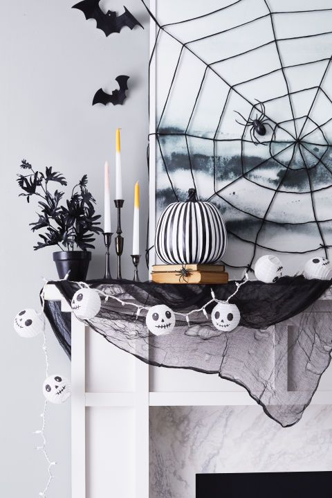 Weave a Web: String a creepy crawling cobweb over artwork or a mirror you already have for the eeriest undead effect. Click through for more enchanting Halloween decorating ideas!