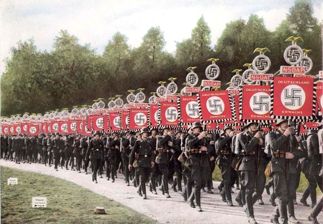 Nuernberg, Germany, SA soldiers carrying flags on the fifth Parteitag, 1933.