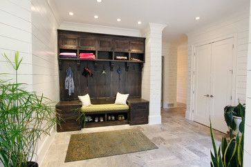 entryway/foyer:  White shiplap horizontal panels on the wall with a cubby of dark, weathered built-in storage with contemporary lines || A Lake Home - transitional - entry -