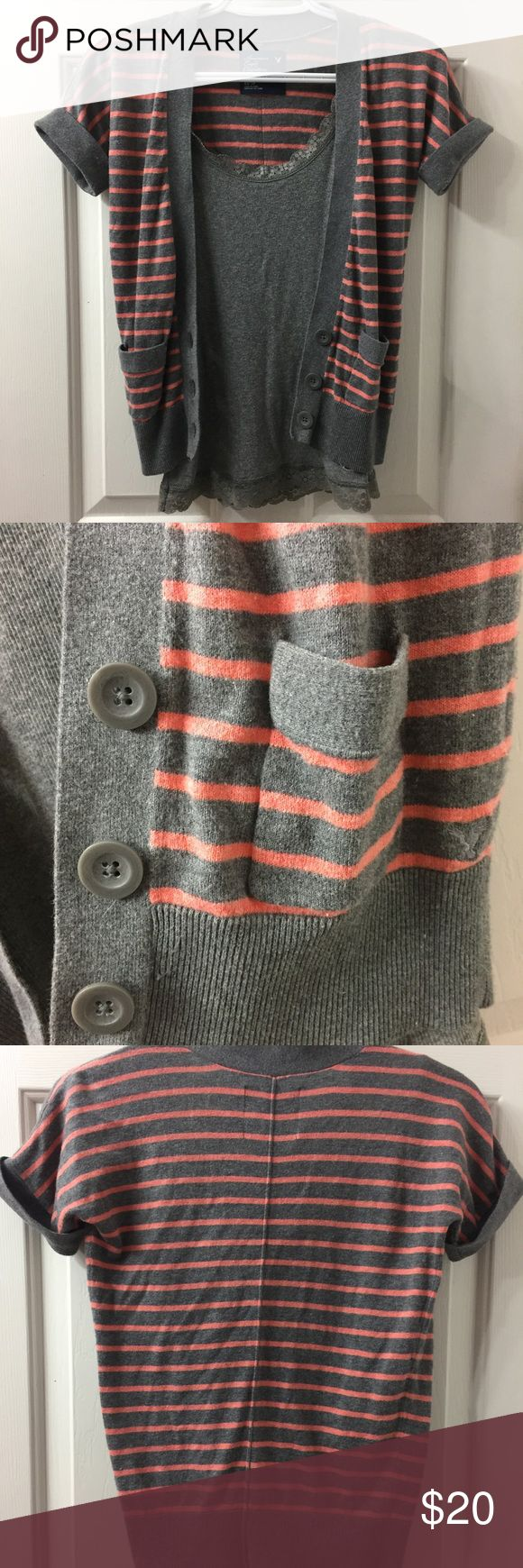 Gray and Salmon striped short sleeve Cardigan American Eagle cardigan. Perfect to layer over tops and tanks. A good neutral color that can easily transition from summer to fall. Tank in picture is not included but can negotiate a bundle. It is also an XS from Hollister. American Eagle Outfitters Sweaters Cardigans