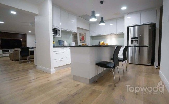 Topwood Oak Flooring, Colour: Cannes, Light Limed Oak Flooring with Black Granite bench top Pure Floors Perth WA Australia