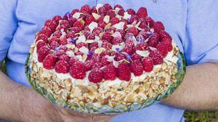 Bent Stiansen cream cake with raspberries, vanilla cream and hazelnuts