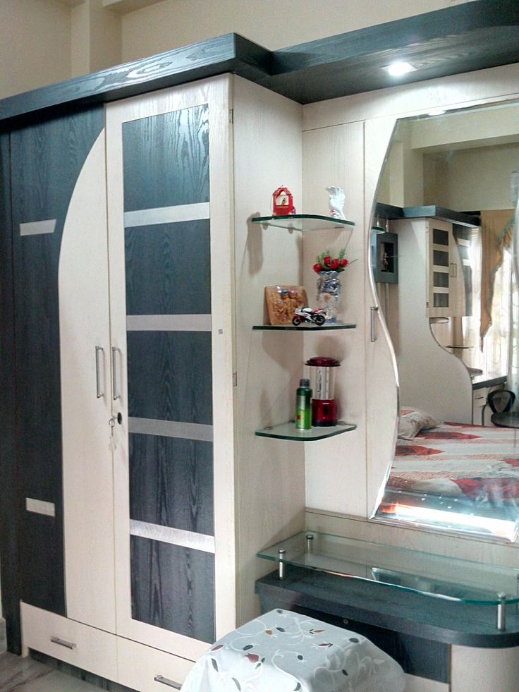 Wardrobe design in bedroom provisioning dressing table gharexpert dream home ideas for Decolam designs for bedroom