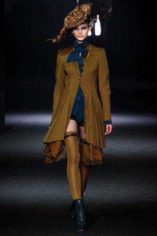 John Galliano Why I Like It: Sexy, yet sophisticated. Thigh-highs, Simple duo-colors. A-line. Widening of the shoulders