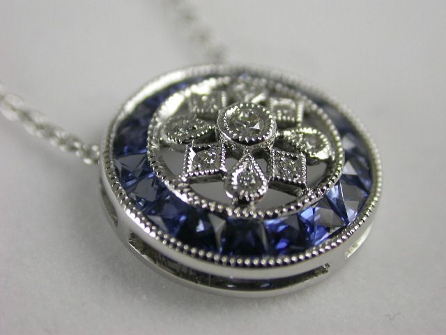 Pretty #Diamond and Blue #Sapphire #Pendant. 18ct. white #gold with daisy-type inner setting with #diamonds bead set and surrounded by trapez-cut Blue Sapphires. Price: $2200.00