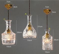 Crystal decanters turned into pendant lighting, what a fun and unique idea!