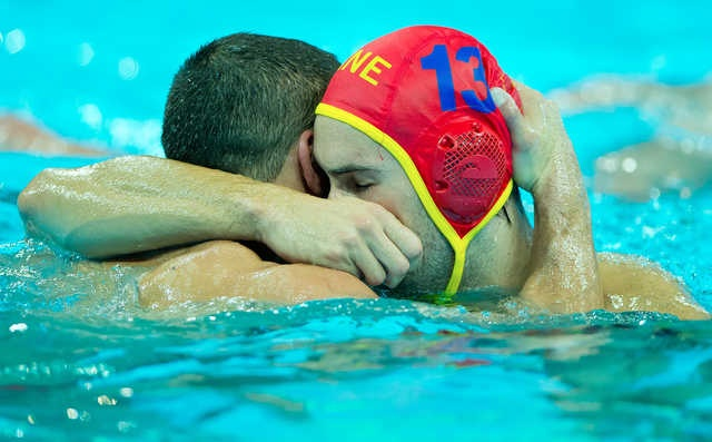 Montenegro's Milos Scepanovic (13) celebrated a shot block on goal with teammate Aleksandar Ivovic (9) in the men's water polo quarterfinal match at the Water Polo Arena in Olympic Park during the 2012 Summer Olympic Games in London, England, Wednesday, August 8, 2012. Montenegro advanced with a 11-9 victory