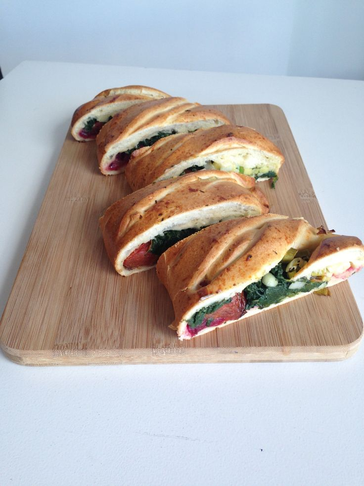 Vegetarian stuffed brioche filled with Italian roast tomatoes, spinach, leeks, and cranberries.