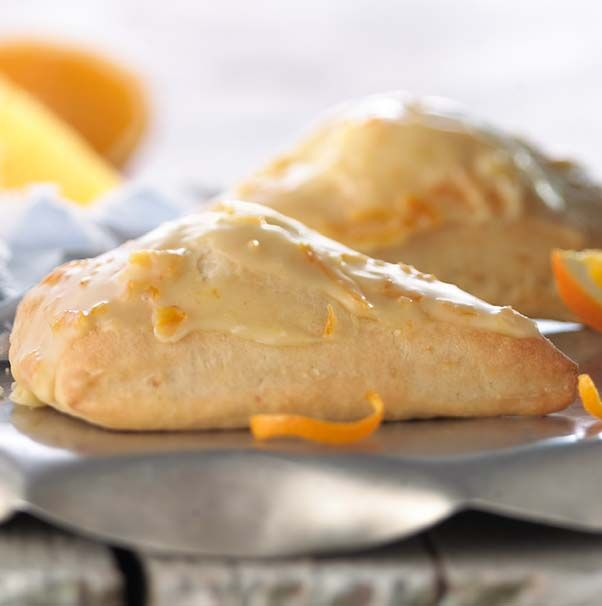 I love Panera Bread orange scones! Made with flour, butter, brown sugar and orange peel and topped with orange icing.