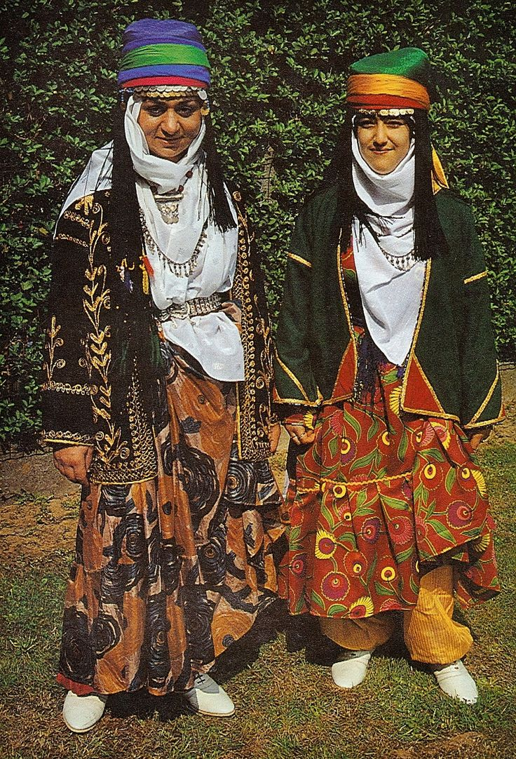 Traditional Kurdish holiday/festive attire from the Diyarbakır region.  2nd half of 20th century (and still in vogue).  The long robes are printed silk (left) or cotton (right).  The long-sleeved vest is generally reversible: one side adorned with patchwork (the costume on the right), the other side embellished with (machine-made, since the 1960s) 'golden' lurex embroidery.  (Kavak Folklor Ekibi & Costume Collection-Antwerpen/Belgium).