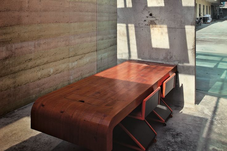 Hefty wooden furniture echoes the solid, monolithic qualities of these timeless structures | Modular Pavilion, Shanghai – SIREWALL | Structural Insulated Rammed Earth