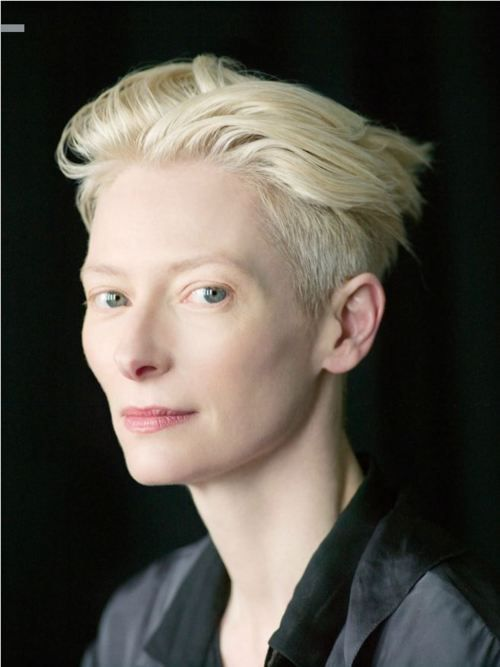 I just love (crazy envious of) her beautiful skin! PERFECT White Witch!   tilda swinton, photo by michael lavine for bust magazine. make-up: devra kinney; stylist: priscilla polley.