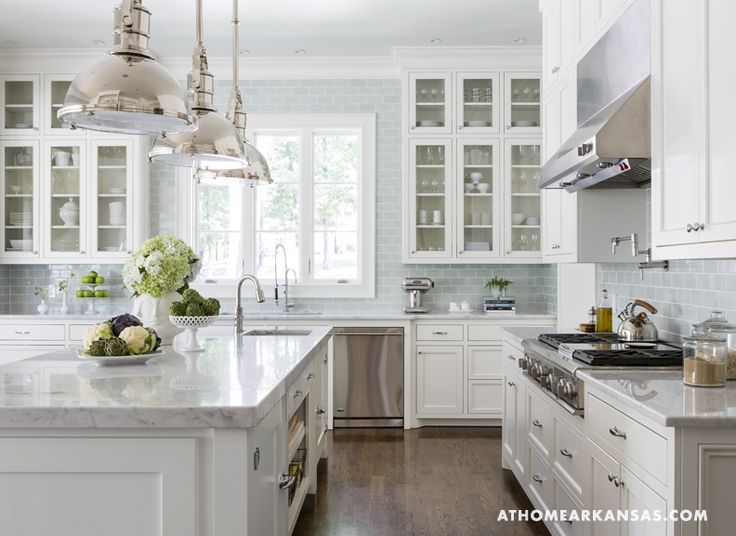 Beautiful combination of white and light grey/blue.  Love the green accents.  Gorgeous kitchen with carrera marble counters, glass cabinet doors, white and clear dishware.  So simple, yet so lovely.