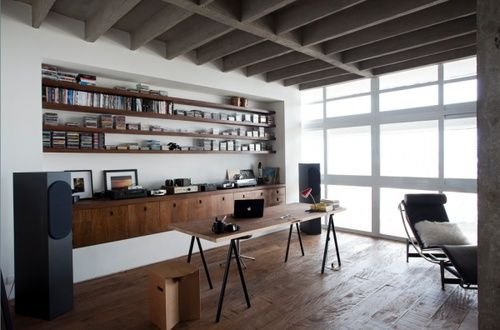 Built in shelving - I like that a desk could be pushed up to this without the shelves impeding the space, and I love the modern feel it has