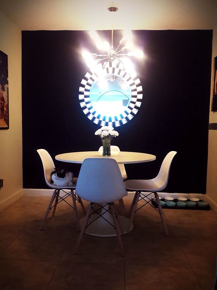 Sputnik 12 light Chandelier. Docksta Dining Table. Eames Eiffel Chairs. Mirror ordered from Amazon. Loving my new dining room decor.