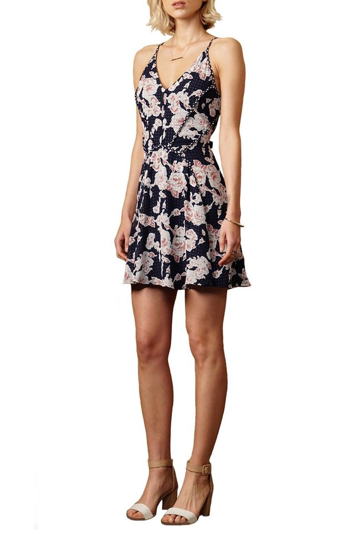 The Serina dress features a detailed floral print self with a contrast checkered layer that gives it an ethereal look. It is brought together with a concealed side zipper and is fully lined. Pair with strappy heels and layers of jewelry to complete the look.   Serina Dress by Greylin. Clothing - Dresses California