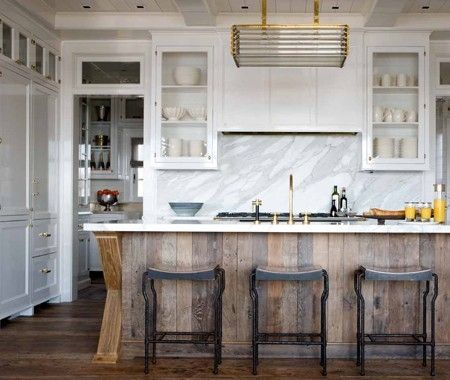 reclaimed wooden island. White worktop.