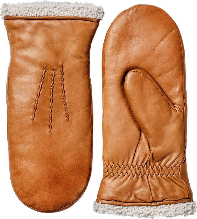 Elegant mittens med lambskin for the coldest day of the year. Forchettes on the side for bigger volume and better insulation.