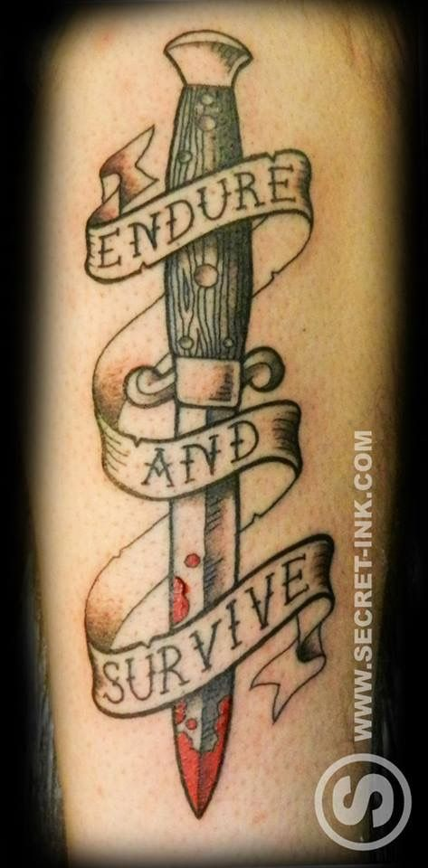neo traditional knife or dagger tattoo