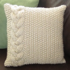 Braided cable chunky hand knit cushion.
